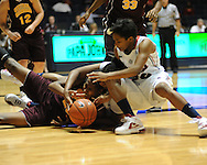 """Central Michigan's Crystal Bradford (23) and Ole Miss' Nikki Byrd (22) go for a loose ball at C.M. """"Tad"""" Smith Coliseum in Oxford, Miss. on Wednesday, December 14, 2011. (AP Photo/Oxford Eagle, Bruce Newman)"""