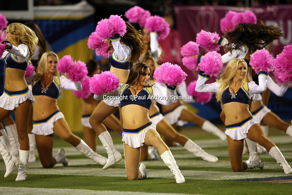 The San Diego Chargers cheerleaders wave pink pom poms in honor of breast cancer awareness during a dance routine at the San Diego Chargers 2015 NFL week 5 regular season football game against the Pittsburgh Steelers on Monday, Oct. 12, 2015 in San Diego. The Steelers won the game 24-20. (©Paul Anthony Spinelli)
