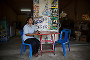 Junaporn Charoensuk, 38, sits in her small shop in the village of Kai Nok Noi in Ubon Ratachatani Province. On the 25th May 2016 her husband Sa-nga Hiranyabut, 40, died of Melioidosis after contracting it in his rice field. <br /> <br /> Melioidosis, though hardly heard of, is Thailand's third largest killer after AIDS and TB. Experts estimate that Melioidosis, caused by a shape-shifting bacteria that lives in water and soil, has 165,000 new cases world-wide a year and that more than half result in death. That means Melioidosis kills roughly the same number as measles or dengue across the globe. <br /> <br /> The bacteria is highly endemic in Northeast Thailand where around 2000 cases are reported per year and mostly from rice farmers who have regular contact with the soil. If not treated and the patients have other complications such a diabetes the mortality rate can be as high as 90% within 5 days.<br /> <br /> If a patient is treated, every case involves a minimum of 2 weeks in hospital followed by 20 weeks of antibiotic treatment and annual followups for the rest of their lives.<br /> <br /> Melioidosis, placed in the same microorganism grouping as anthrax by the US government, is a deadly neglected tropical disease that very few have even heard of.