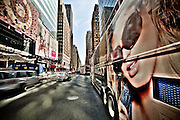 Wide-angle picture of a double-decker bus on 7th Avenue in Times Square, Manhattan, New York.