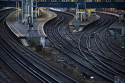 © Licensed to London News Pictures. 13/12/2016. London, UK. Empty platforms and tracks during the morning rush hour at Clapham Junction Station as an ASLEF union train drivers strike takes hold. Photo credit: Peter Macdiarmid/LNP