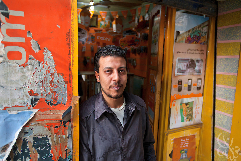 Ahmed Helmy, age 33, poses for a portrait outside his mobile phone shop October 27, 2011 in the Egyptian village of Warwara, just outside the Delta city of Benha around 50 kilometers north of Cairo.  (Photo by Scott Nelson)