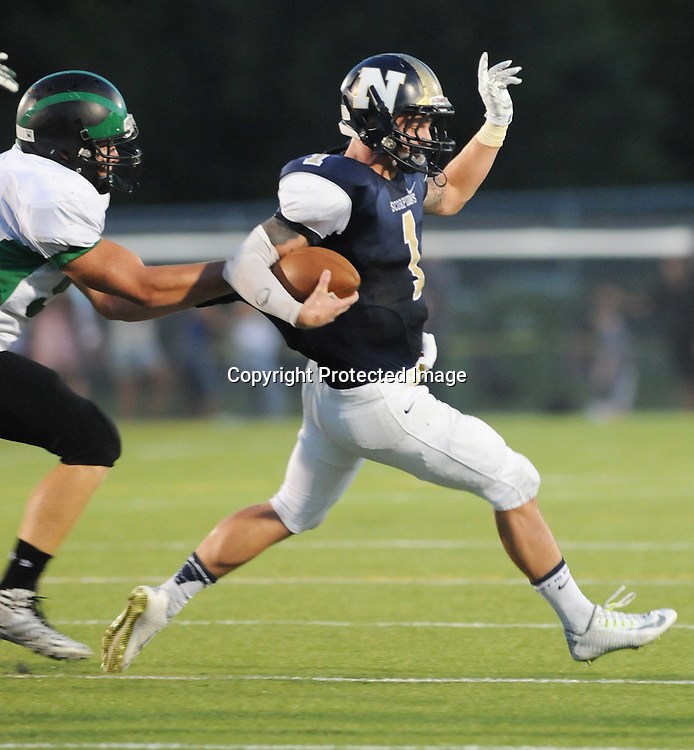 North Brunswick's Hunter Hendershot breaks the tackle of a West Brunswick player in the third game of the 28th Annual BB&T Football Jamboree Friday August 15, 2014 at Legion Stadium in Wilmington, N.C. (Jason A. Frizzelle)