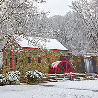 New England snow covered country scenery winter photography of the Sudbury Grist Mill at the Wayside Inn Historic District. This local New England landmark is in Sudbury, Massachusetts. <br />