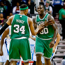 Mar 20, 2013; New Orleans, LA, USA; Boston Celtics power forward Brandon Bass (30) celebrates with small forward Paul Pierce (34) during the second quarter of a game against the New Orleans Hornets at the New Orleans Arena. Mandatory Credit: Derick E. Hingle-USA TODAY Sports