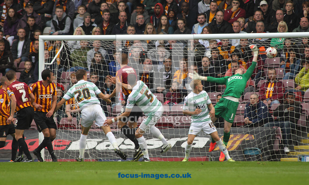 Aaron Martin (C) of Yeovil Town heads the ball to score the  goal against Bradford City during the Sky Bet League 1 match at the Coral Windows Stadium, Bradford<br /> Picture by Stephen Gaunt/Focus Images Ltd +447904 833202<br /> 06/09/2014