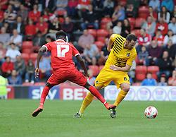 Tom Parkes of Bristol Rovers is challenged by Blair Turgott of Leyton Orient - Mandatory byline: Neil Brookman/JMP - 07966386802 - 29/08/2015 - FOOTBALL - Matchroom Stadium -Leyton,England - Leyton Orient v Bristol Rovers - Sky Bet League Two