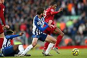 Brighton and Hove Albion midfielder Davy Propper (24) takes on Liverpool midfielder Georginio Wijnaldum (5) during the Premier League match between Liverpool and Brighton and Hove Albion at Anfield, Liverpool, England on 30 November 2019.