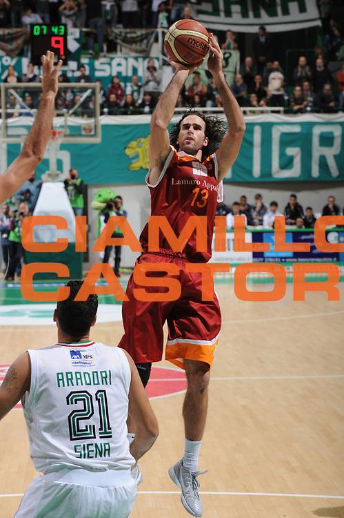 DESCRIZIONE : Siena Lega A 2011-12 Bancatercas Teramo Montepaschi Siena<br /> GIOCATORE : Luigi Datome<br /> CATEGORIA : three points<br /> SQUADRA : Virtus Roma<br /> EVENTO : Campionato Lega A 2011-2012<br /> GARA : Montepaschi Siena Virtus Roma<br /> DATA : 05/11/2011<br /> SPORT : Pallacanestro<br /> AUTORE : Agenzia Ciamillo-Castoria/GiulioCiamillo<br /> Galleria : Lega Basket A 2011-2012<br /> Fotonotizia : Siena Lega A 2011-12 Montepaschi Siena Virtus Roma<br /> Predefinita :