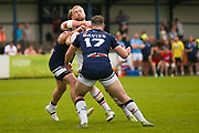 Bradford Bulls replacement Mikolaj Oledzki (31) is tackled  during the Kingstone Press Championship match between Swinton Lions and Bradford Bulls at the Willows, Salford, United Kingdom on 20 August 2017. Photo by Simon Davies.