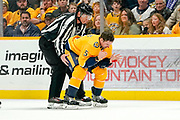 Nashville Predators defenseman Dan Hamhuis (5) skates off the ice after taking a puck to the face during a game between the Pittsburgh Penguins and Nashville Predators at Bridgestone Arena in Nashville, TN December 27, 2019