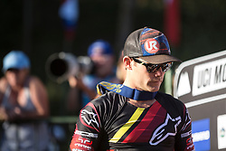 Mick Hannah steps down from the hot seat, walking towards Aaron Gwin to congratulate him at the 2014 UCI Mountainbike World Cup in Pietermaritzburg, South Africa.