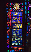 Stained glass in Sacred Heart Chapel created by Union de Artistas of Vidrieros Irun, Spain; National Hansen's Disease Museum buildings tour at Carville, Louisiana on January 30, 2019