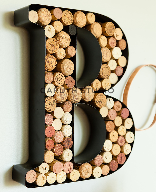 Metal monogram bar sign filled with corks