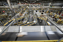 Embargoed to 0001 Friday November 16 Parcels fly past on conveyor belts at Amazon's fulfillment centre in Swansea, in the run up to Black Friday.
