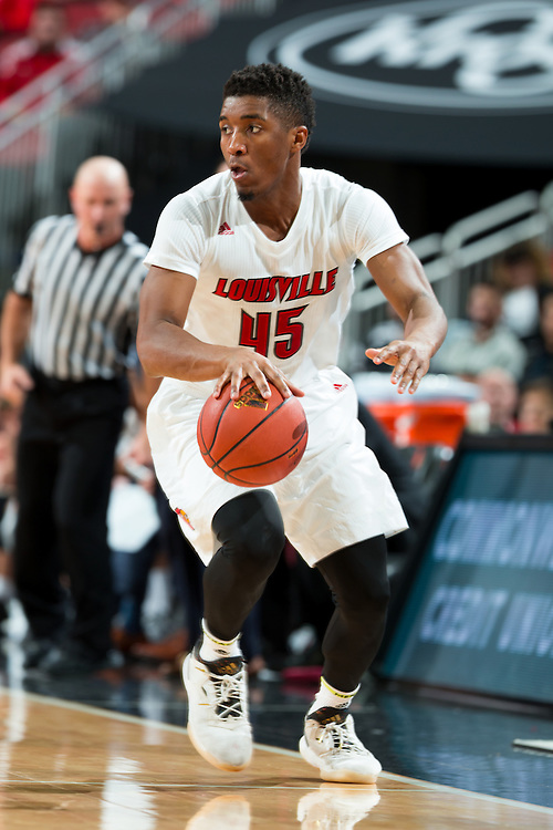 Louisville guard Donovan Mitchell brings the ball up the floor in the second half. The University of Louisville hosted Eastern Kentucky University, Saturday, Dec. 17, 2016 at The KFC Yum Center in Louisville. Louisville won 87-56.