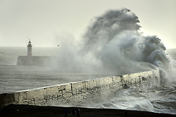 © Licensed to London News Pictures. 03/01/2018. Newhaven, UK.  People watch huge waves crash against Newhaven Breakwater, East Sussex, as Storm Eleanor passes.  Photo credit: Peter Cripps/LNP