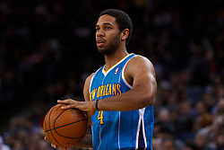 Mar 28, 2012; Oakland, CA, USA; New Orleans Hornets shooting guard Xavier Henry (4) holds the ball against the Golden State Warriors during the second quarter at Oracle Arena. New Orleans defeated Golden State 102-87. Mandatory Credit: Jason O. Watson-US PRESSWIRE