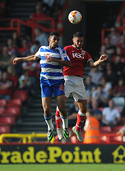 Derrick Williams of Bristol City challenges for the header with Nick Blackman of Reading - Mandatory byline: Dougie Allward/JMP - 07966 386802 - 19/09/2015 - FOOTBALL - Ashton Gate - Bristol, England - Bristol City v Reading - Sky Bet Championship