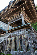 "One of many buildings at Kumano Nachi Taisha shrine, in Nachikatsuura, Higashimuro District, Wakayama Prefecture, on the Kii Peninsula, Honshu, Japan. Kumano Nachi Taisha shrine was built in homage to Nachi-no-Taki waterfall's kami (spirit god). Don't miss the iconic view of thundering Nachi-no-Taki waterfall (133 m, Japan's tallest) paired with Seiganto-ji pagoda. Kumano Nachi Taisha shrine fuses Buddhist and Shinto influences along the 1000+ year pilgrimage routes of Kumano Kodo. For most of their history, the Buddhist Seiganto-ji and Shinto Kumano Nachi Taisha shrine functioned as one religious institution. The ""Sacred Sites and Pilgrimage Routes in the Kii Mountain Range"" form an impressive entry on UNESCO's List of World Heritage Sites. Access: by bus from Nachi Station (20 min) or Kii-Katsuura Station (30 min). Ask driver to stop at base of the Daimonzaka trail (""Daimonzaka"" stop); or at the entrance to Nachi Waterfall (""Taki-mae""); or at the bus terminus 10 minutes climb below Nachi Shrine (""Nachi-san""). Cars can park at Seigantoji Temple. I recommend this remarkably scenic, short walk (3.5 km with 265 meters gain): starting from Daimon-zaka bus stop, ascend a stone-paved path, humbled by massive evergreens, up to the gates of Nachi Taisha shrine, descend to Seiganto-ji pagoda, then to the falls, just below Taki-mae bus stop."