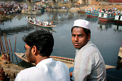 BANGLADESH TONGI 4FEB07 - Two Bangladeshi men watch boats carrying worshippers arrive at Tongi bridge during the last day of the BiswaIjtema outside Tongi, a northern suburb of the capital city Dhaka. The annual Tablighi Jamaat Islamic movement congregation lasts three days and is attended by over two million Muslims, making it the second largest congregation after the Hajj to Mecca. Devotees from approximately 80 countries, including the host country, Bangladesh, attend the three-day Ijtema seeking divine blessings from Allah. The event focuses on prayers and meditation and does not allow political discussion. The local police estimated the number of attendees of the 2007 Ijtema to be 3 million...jre/Photo by Jiri Rezac..© Jiri Rezac 2007..Contact: +44 (0) 7050 110 417.Mobile:  +44 (0) 7801 337 683.Office:  +44 (0) 20 8968 9635..Email:   jiri@jirirezac.com.Web:    www.jirirezac.com..© All images Jiri Rezac 2007 - All rights reserved.