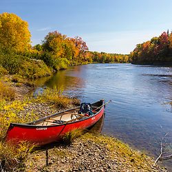 A canoe on the East Branch of the Penobscot River in Maine's Northern Forest. Fall.