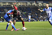 Ishmael Miller,Greg Halford and Bruno Saltor  draw it out at the AMEX during the Sky Bet Championship match between Brighton and Hove Albion and Huddersfield Town at the American Express Community Stadium, Brighton and Hove, England on 14 April 2015. Photo by Stuart Butcher.