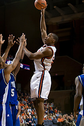 Virginia forward/center Jerome Meyinsse (55) shoots a hook over Hampton Pirates guard Brandon Tunnell (5).  The Virginia Cavaliers men's basketball team defeated the Hampton Pirates 79-65 at the John Paul Jones Arena in Charlottesville, VA on December 19, 2007.