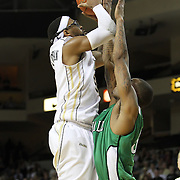 Central Florida guard Marcus Jordan (5) shoots over Marshall forward Johnny Thomas (0) during a Conference USA NCAA basketball game between the Marshall Thundering Herd and the Central Florida Knights at the UCF Arena on January 5, 2011 in Orlando, Florida. Central Florida won the game 65-58 and extended their record to 14-0.  (AP Photo/Alex Menendez)