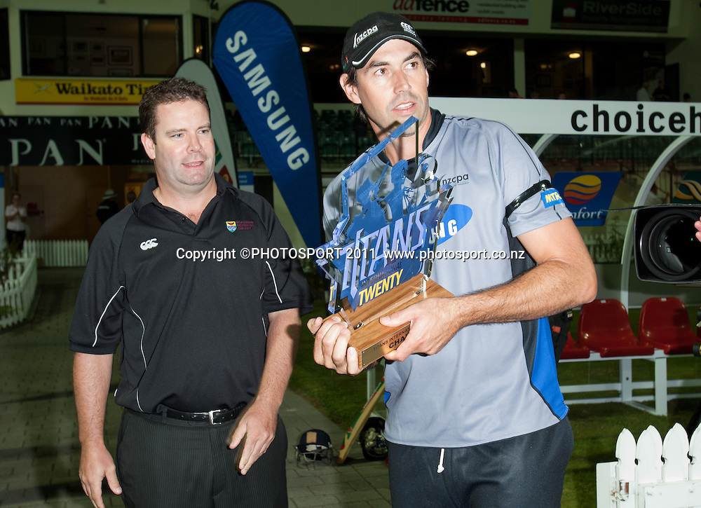 Northern Districts Cricket's David Cooper presents Stephen Fleming with the winning trophy after the Titans International Twenty20 Cricket, Samsung NZCPA Masters XI v Australia, Seddon Park, Hamilton, New Zealand, Thursday 24 February 2011. Photo: Stephen Barker/PHOTOSPORT