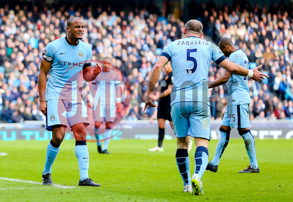 Manchester City's Vincent Kompany shows his frustration after conceding the opening goal - Photo mandatory by-line: Matt McNulty/JMP - Mobile: 07966 386802 - 07/02/2015 - SPORT - Football - Manchester - Etihad Stadium - Manchester City v Hull City - Barclays Premier League