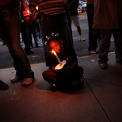 Kyle Green | The Roanoke Times<br /> 9/21/2011 Eight year old Malasia Witcher holds a candle during a prayer at a  candlelight vigil that was held for Shirley Hodges, 64, of Rocky Mount, on the three-week anniversary of her disappearance. Hodges&Otilde; husband died, apparently by suicide, in a Texas motel the day Hodges&Otilde; daughter reported her missing. Investigators have said they suspect foul play.