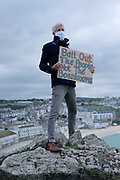 Climate change activists from the group 'No Going Back – another world is possible', taking part in a social distancing protest on 4th May 2020 in St Ives, Cornwall, United Kingdom. This is the first of it's kind and the group are hoping that the idea will spread across the UK. The idea is that every Sunday at 10.00am people will protest in this way. They are all members of Extinction Rebellion who have helped disseminate the idea across the XR groups across the UK. Because of Covid 19 there has been very little climate change protest and the group think this is a way to protest. These protests are highlighting that the government is not doing enough to avoid catastrophic climate change and to demand the government take radical action to save the planet.