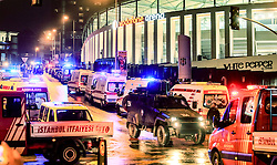 Terror in der T¸rkei: Zwei Bombenanschl‰ge nach dem Fussballspiel Besiktas gegen Bursaspor nahe der Vodafone-Arena in Istanbul fordern Todesopfer unter den Polizeikr‰ften / 101216<br /> <br /> ***Ambulances line up as police forensic officers examine the blast area outside a soccer stadium in Istanbul, Saturday night, December 10, 2016.  Nearly 38 people, mostly police officers lost their lives after twin bomb attacks outside the stadium in Istanbul Saturday night following a soccer game.***