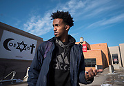 Mohamed Warsame, president of the Somali Student Association, stands by a banner that has hung on campus for years at St. Cloud State University in St. Cloud, Minnesota. Warsame is proud of the vast diversity among the student body, and he feels safe in the progressive university community. The city feels different, he says.