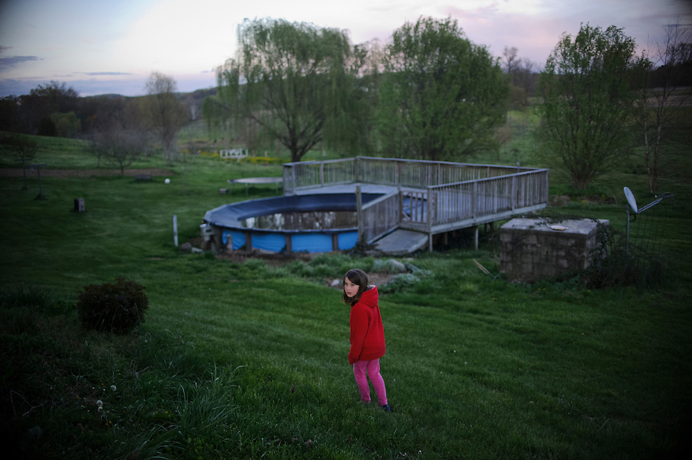 photo by Matt Roth.Wednesday, April 11, 2012..Rory Shriver walks around her grandparents' backyard...Ron Shriver grew up on a large farm house in Pleasant Valley, Maryland, a small township outside Westminster. After his lease was up, he moved back to his parent's home with his two children Rory and Miles, living temporarily in their basement before graduating from McDaniel College in May. After tossing his graduation cap, he and his children will drive cross country to meet up with his wife who has been working on her graduate degree in Alaska. ..Ron Shriver is a retired marine staff sergeant. He is also the first in his family to attend college, thanks to the New G.I. Bill. His wife, a fellow retired Marine, is finishing up graduate school in Alaska. After Ron gets his undergraduate degree from McDaniel College in May, he plans to drive to Alaska with is two children Rory, 6, and Miles, 5. For the move Ron got rid of most of his family's belongings, and after his lease was up, he and his children moved back into his parent's farmhouse.