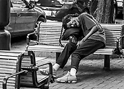 Fatigued Charlottean on North Tryon St in Uptown Charlotte, North Carolina