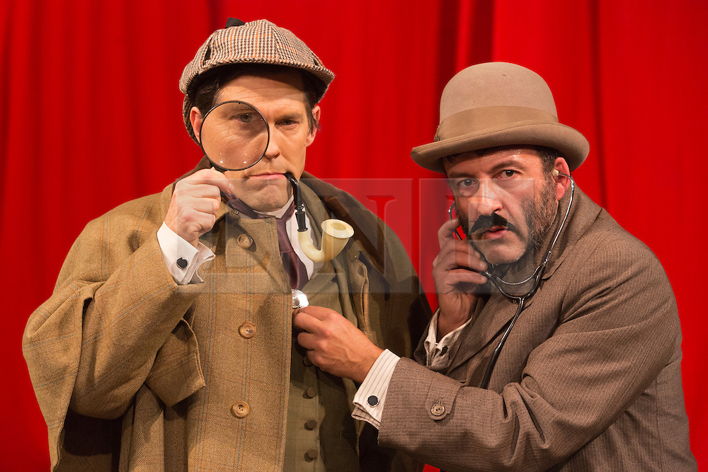 "© Licensed to London News Pictures. 28/11/2014. London, England. Toby Park as Holmes and Aitor Basauri as Dr Watson. Spymonkey company present ""Mrs Hudson's Christmas Corker! Or 'Your Goose is Cooked Mr Holmes' ..."" at Wilton's Music Hall, London. Written by Barry and Boy Cryer, the Christmas show takes place at 221B Baker Street with a tale based on the Sherlock Holmes legend by Sir Arthur Conan Doyle. Performances from 2 to 31 December 2014. With actors: Aitor Basauri (Dr Watson), Petra Massey (Mrs Hudson), Toby Park (Sherlock Holmes) and Sophie Russell. Photo credit: Bettina Strenske/LNP"