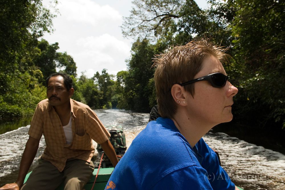 Susan Cheyne travelling by river to Kalaweit Project.