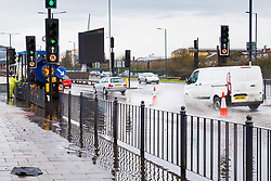 A night of heavy rain in London leaves part of two lanes of the westbound A40 in Park Royal flooded, with workers attempting to clear blocked drains. London, April 02 2018.
