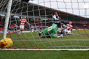 Richard Chaplow of Doncaster Rovers on ground  scores goal to go level at 1 all  during the Sky Bet League 1 match between Doncaster Rovers and Millwall at the Keepmoat Stadium, Doncaster, England on 27 February 2016. Photo by Ian Lyall.
