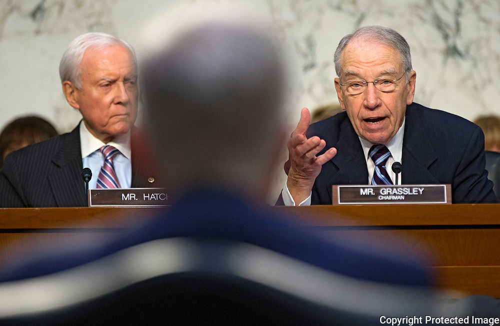 Sen. Chuck Grassley (right) motions towards Neil Gorsuch (center) while talking about taking a short break while Sen. Orrin Hatch (left) looks on during a hearing in the Senate Judiciary Committee for Judge Gorsuch to become an Associate Justice of the United States Supreme Court in the Hart Senate Office Building in Washington, D.C. on Monday, Mar. 20, 2017.