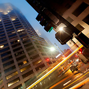Fog and bus motion blur in the evening at 11th and Baltimore Avenue, downtown Kansas City, Missouri.