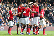 GOAL - Manchester United Midfielder Paul Pogba celebrates with Manchester United Defender Chris Smalling and Manchester United Midfielder Nemanja Matic 0-3 during the Premier League match between Fulham and Manchester United at Craven Cottage, London, England on 9 February 2019.