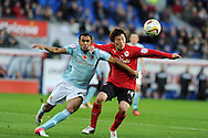 Cardiff city's Kim Bo-Kyung ® battles for the ball with Hull's Ahmed Elmohamady (l). NPower championship, Cardiff city v Hull city at the Cardiff city stadium in Cardiff, South Wales on Saturday 10th November 2012.  pic by Andrew Orchard, Andrew Orchard sports photography,