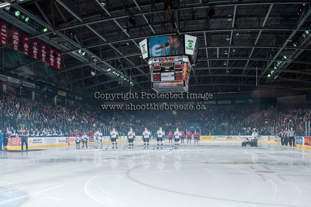 KELOWNA, CANADA - MARCH 7: The Kelowna Rockets line up during the national anthem against the Spokane Chiefs on March 7, 2015 at Prospera Place in Kelowna, British Columbia, Canada.  (Photo by Marissa Baecker/Shoot the Breeze)  *** Local Caption *** crowd; fans; line up;