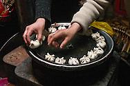 Mongolia. preparing new year in Gambolt family. dinner , littke dumpling with mutton meat called BUUZ. cattle breeder in Uyanga area during Tsagaan sar, mongol new year, called white month  aymak -   /  preparation du nouvel an, le repas de BUUZ, petit dumpling avec de la viande de mouton. dans la yourte de la famille  Gambolt . famille díeleveurs dans la region de Uyanga. pendant Tsagaan sar, nouvel an mongol le mois blanc,   ovorkangai province - Mongolie /  L0009102D