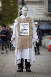 © Licensed to London News Pictures. 16/10/2019. London, UK. An Extinction Rebellion protester wearing a costume stands on Whitehall. The protests over inaction to tackle the climate crisis have led to more than 1,400 arrests in London. Photo credit: Rob Pinney/LNP