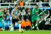 Yoshinori Muto (#13) of Newcastle United dribbles the ball forward pursued by Etienne Capoue (#29) of Watford during the Premier League match between Newcastle United and Watford at St. James's Park, Newcastle, England on 3 November 2018.