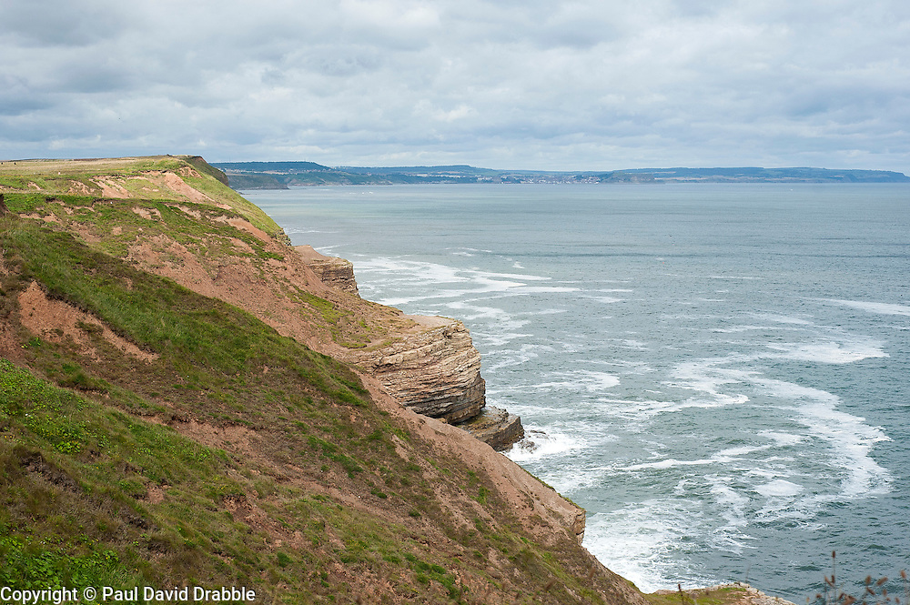 Looking from the cleveland way cliff top path north of Filey along the coast towards the seaside holiday resort of Scarborough